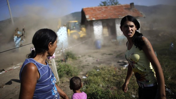 Homeless: Roma women react as their houses are demolished in Bulgaria