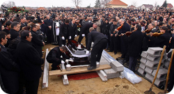 A Roma man and his 4-year-old son were buried together in March in Hungary. (Photo: Peter Takacs/Agence France-Presse - Getty Images)